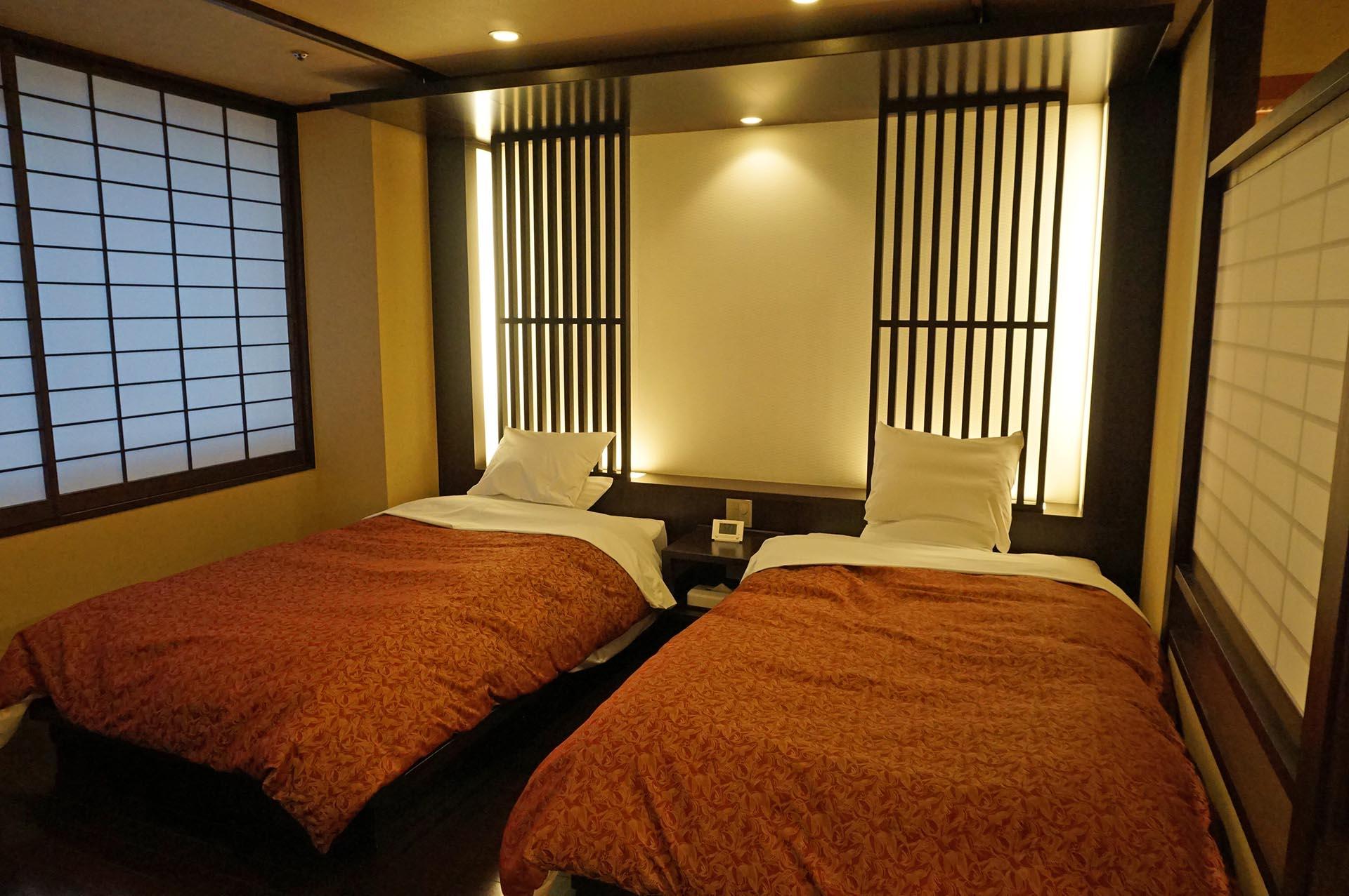 ユウベルホテル松政のベッド